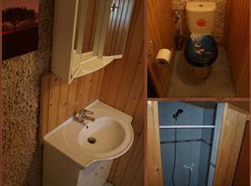 První koupelna s umyvadlem, sprchovým koutem a toaletou