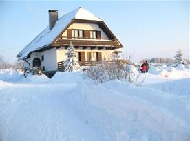 Zimní pohled na rekreační dům