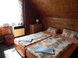 Chata - ložnice s manželským dvoulůžkem