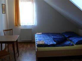 Apartmán s lůžky v podkroví