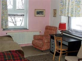 dvoulůžkový pokoj s posezením