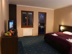 Dvoulůžková ložnice v apartmánu