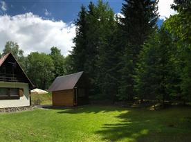 Dřevěný domek pro úschovu kol