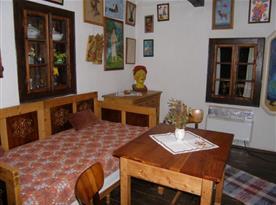 Obytná místnost s lůžkem