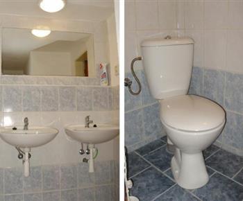 Koupelna s umývadlem, sprchovým koutem a toaletou