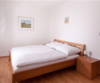 Ložnice v apartmánu pro 2 - 4 osoby