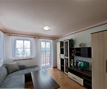 Obývací pokoj v apartmánu v přízemí