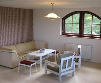 Apartmán B - obývací pokoj se sedačkou